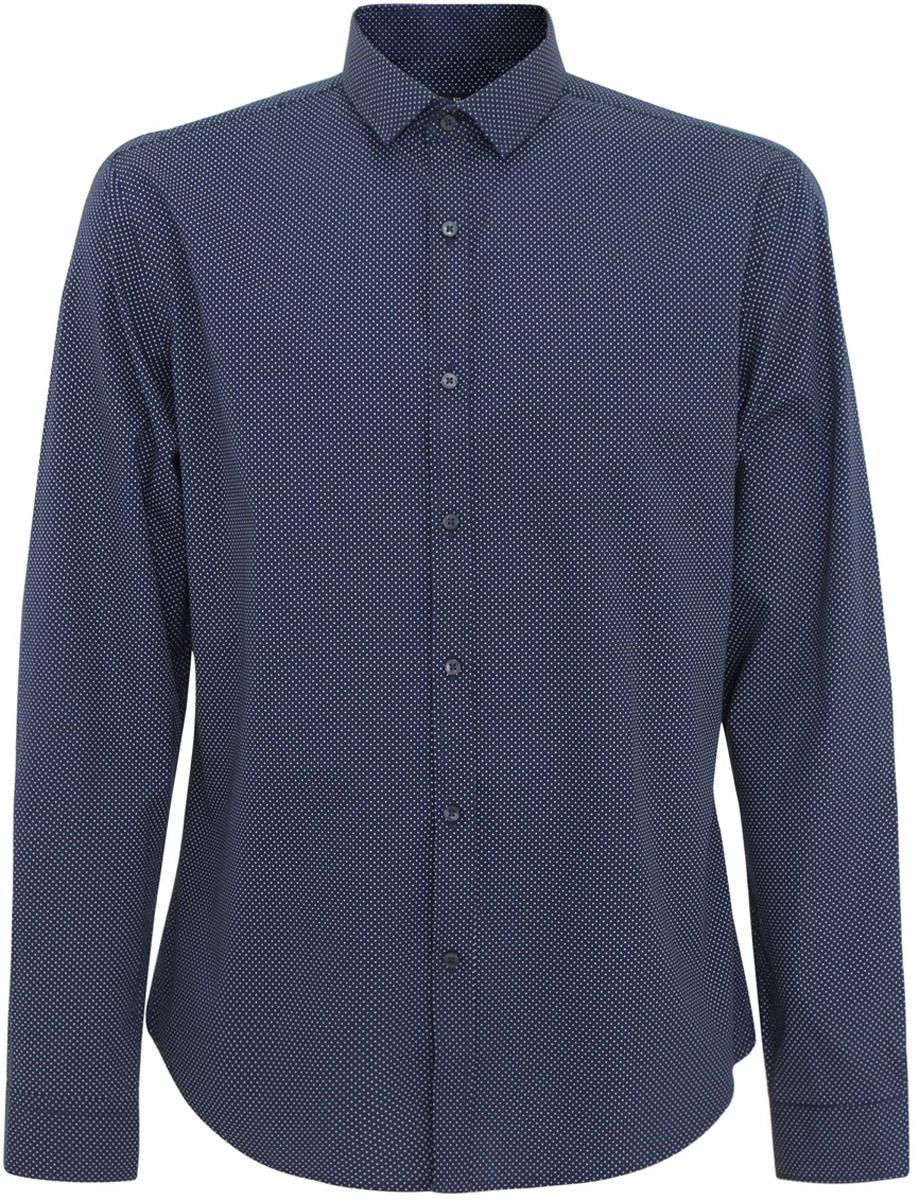 Рубашка3L110116M/19370N/7910DСтильная мужская рубашка oodji выполнена из натурального хлопка. Модель с отложным воротником и длинными рукавами застегивается на пуговицы спереди. Манжеты рукавов дополнены застежками-пуговицами. Оформлена рубашка принтом в мелкий горох