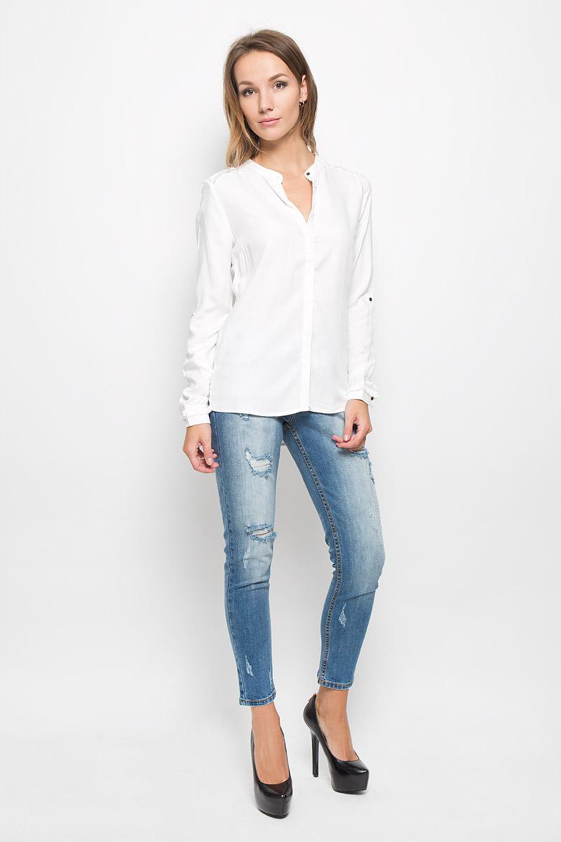 БлузкаB-312/1133-6313Женская блузка Sela Casual, выполненная из мягкой вискозы, идеально дополнит ваш образ. Материал изделия приятный на ощупь, не стесняет движений и хорошо пропускает воздух, обеспечивая комфорт. Блузка с круглым вырезом горловины и длинными рукавами застегивается по всей длине на пуговицы, скрытые за планкой. Модель имеет приталенный силуэт. Манжеты имеют застежки-пуговицы. Длину рукавов можно регулировать при помощи хлястиков с пуговицами. Спинка блузки удлинена, по бокам предусмотрены небольшие разрезы. По плечевым швам и на манжетах изделие декорировано бахромой. Такая блузка подчеркнет ваш вкус и станет стильным дополнением к вашему гардеробу!