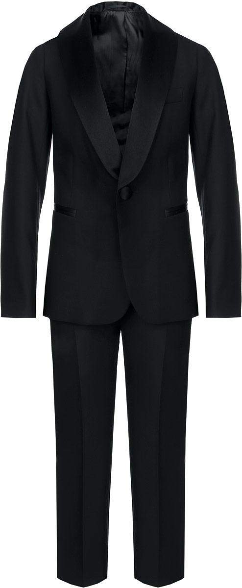 Костюм для мальчика BTC, цвет: черный. 12.017493. Размер 30-13412.017493Классический костюм для мальчика BTC, состоящий из пиджака и брюк, - основа делового стиля, а значит и в школьном гардеробе ребенка - это базовый атрибут, необходимый для будней и праздников. Изготовленный из полиэстера с добавлением вискозы, он необычайно мягкий и приятный на ощупь, не сковывает движения и позволяет коже дышать, не раздражает даже самую нежную и чувствительную кожу ребенка, обеспечивая ему наибольший комфорт. На подкладке используется гладкая подкладочная ткань.Классический пиджак с лацканами застегивается на одну пуговицу. Спереди он дополнен тремя прорезными карманами, один из которых расположен на уровне груди. Сзади имеется шлица. С внутренней стороны модель также дополнена накладным кармашком. Внутренняя обработка пиджака, сделанная по самым высоким стандартам мужской моды, придает костюму солидность.Классические брюки прямого кроя со стрелками на талии застегиваются на пуговицу и имеют ширинку на застежке-молнии, также имеются шлевки для ремня. С внутренней стороны пояс регулируется резинкой на пуговицах, создающей комфортную посадку изделия по фигуре. Спереди брюки дополнены двумя боковыми втачными карманами со скошенными краями.Являясь важным атрибутом школьной моды, классический костюм подчеркивает деловой имидж ученика, придавая ему уверенность.