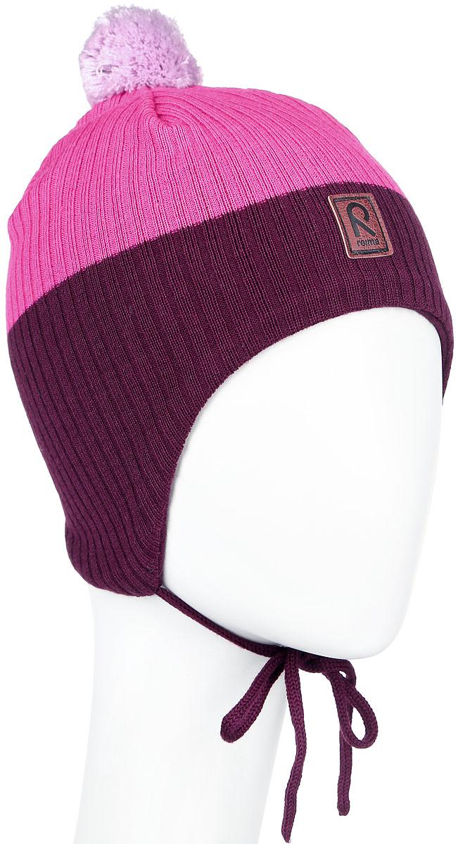 Шапка детская Reima Majava, цвет: розовый, бордовый. 518355-4620. Размер 48518355_4620Детская шапка Reima Majava прекрасно подойдет для прогулок в прохладную погоду. Шапка выполнена из шерсти и акрила, она мягкая и приятная на ощупь, идеально прилегает к голове.Шапка дополнена помпоном на макушке и завязками, которые фиксируются под подбородком. Супер мягкая подкладка из 100% хлопка и ветронепроницаемые вставки в области ушей обеспечат комфорт во время веселых зимних прогулок. Спереди модель дополнена нашивкой с логотипом бренда.Такая шапка станет отличным дополнением к детскому гардеробу, в ней ребенку будет тепло, уютно и комфортно. Уважаемые клиенты!Размер, доступный для заказа, является обхватом головы.