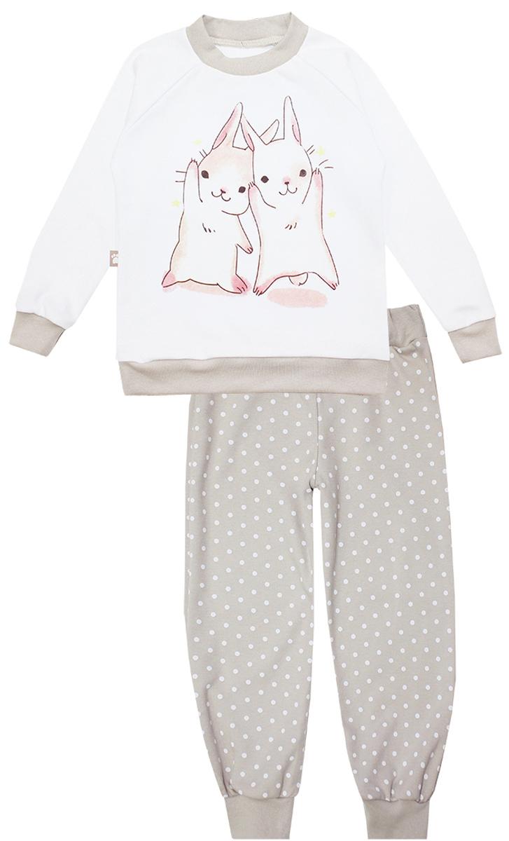 Пижама16550Детская пижама КотМарКот Зайчик включает в себя лонгслив и брюки. Пижама изготовлена из натурального хлопка. Лонгслив с длинными рукавами-реглан и круглым вырезом горловины оформлен принтом с изображением двух забавных зайчиков. Свободные брюки с широкой эластичной резинкой на поясе дополнены трикотажными манжетами по низу брючин. Модель украшена принтом в горох.