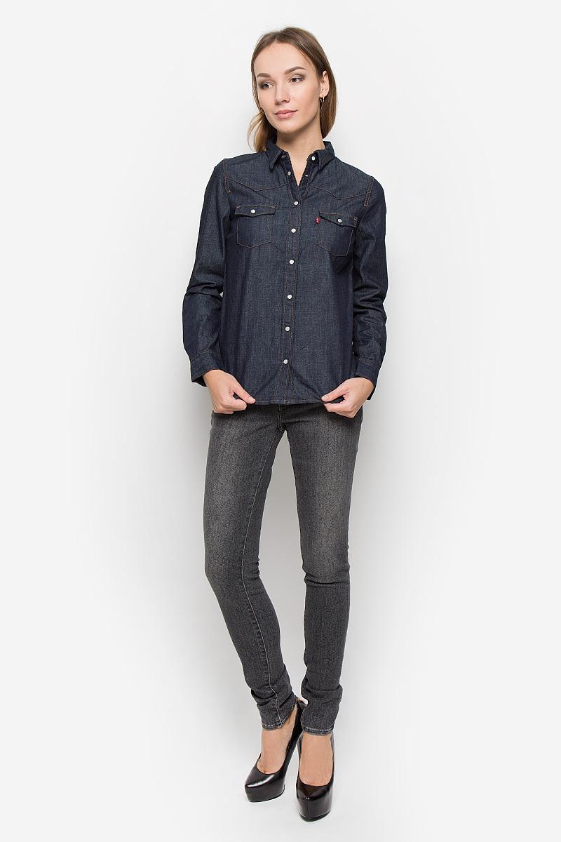 Рубашка2499600020Стильная женская рубашка Levis® выполнена из натурального хлопка. Материал очень мягкий и приятный на ощупь, не сковывает движения и позволяет коже дышать. Рубашка с отложным воротником и длинными рукавами застегивается на кнопки по всей длине. Низ рукавов обработан манжетами на кнопках. Спереди модель дополнена двумя накладными карманами с оригинальными клапанами на кнопках.