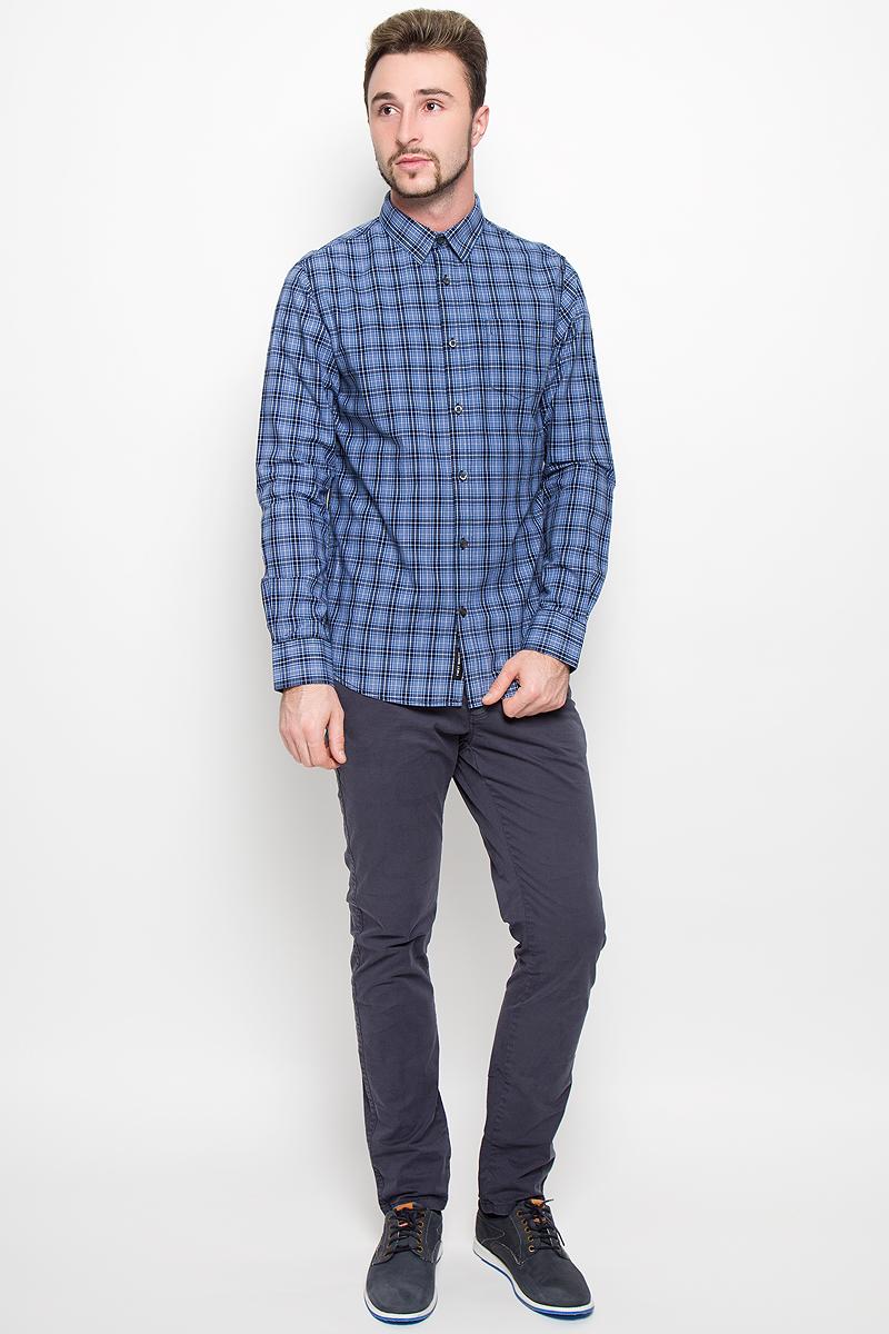 Рубашка мужская Broadway, цвет: синий. 20100281. Размер M (48)20100281_574Стильная мужская рубашка Broadway Teal, изготовленная из натурального хлопка, необычайно мягкая и приятная на ощупь. Модная рубашка с отложным воротником, длинными рукавами и полукруглым низом застегивается на пластиковые пуговицы. Модель оформлена принтом в клетку и на груди слева дополнена накладным кармашком. Рукава рубашки дополнены манжетами на пуговицах.