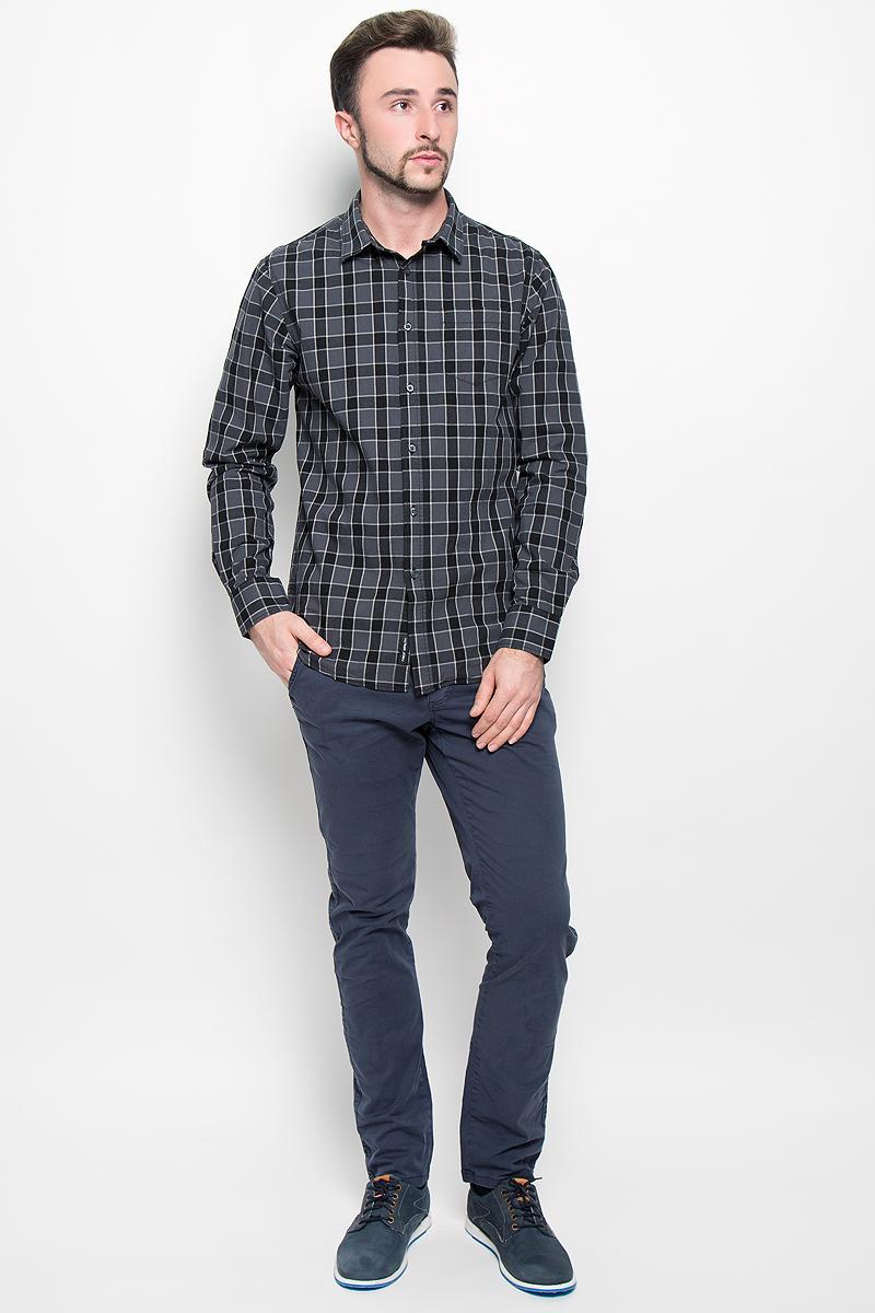 Рубашка мужская Broadway, цвет: темно-серый. 20100277. Размер XL (52)20100277_879Стильная мужская рубашка Broadway, изготовленная из натурального хлопка, необычайно мягкая и приятная на ощупь. Модная рубашка с отложным воротником, длинными рукавами и полукруглым низом застегивается на пластиковые пуговицы. Модель оформлена принтом в крупную клетку и на груди слева дополнена накладным кармашком. Рукава рубашки дополнены манжетами на пуговицах.