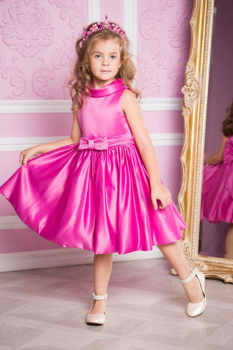 Платье для девочки Sweet Berry, цвет: розово-лиловый. 215908. Размер 98215908Платье для девочки Sweet Berry выполнено из высококачественного атласного материала и дополнено подкладкой из натурального хлопка. Модель сзади застегивается на потайную застежку-молнию. Сзади платье оформлено большим текстильным бантом, а также спереди небольшим бантом украшенным стразами.