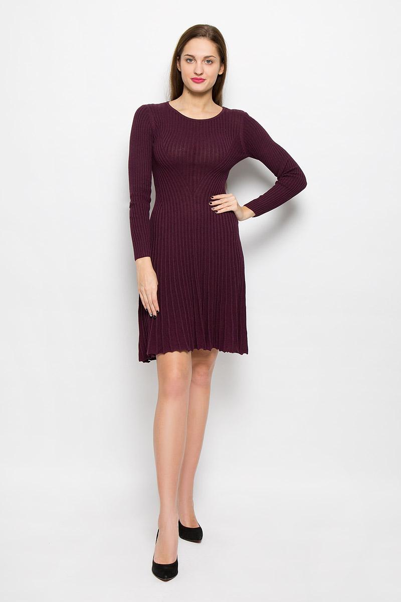 Платье5019411.00.75_5465Стильное платье Tom Tailor, изготовленное из высококачественного хлопка и вискозы, мягкое и приятное на ощупь, не сковывает движения, обеспечивая наибольший комфорт. Модель с длинными рукавами, круглым вырезом горловины связано резинкой.