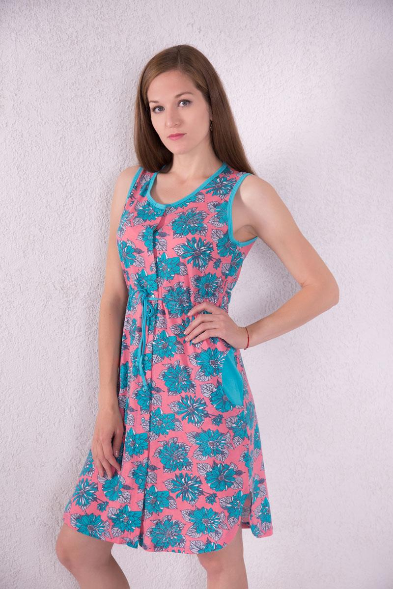 Платье домашнее7117110104Платье-халат Violett выполнено из натурального хлопка. Платье с круглым вырезом горловины застегивается на пуговицы по всей длине. Спереди расположены два кармана. Модель оформлена цветочным принтом. На талии изделие оснащено затягивающимся шнурком.