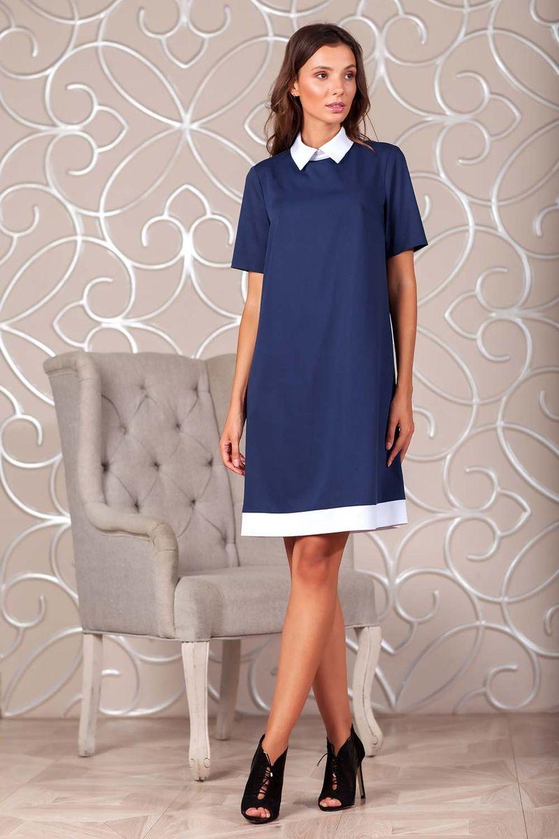 Платье Ruxara, цвет: темно-синий. 0113741. Размер 420113741Элегантное платье из ткани костюмной группы. Модель трапециевидного силуэта с коротким рукавом. Низ платья оформлен полосой контрастного цвета. Воротник отложной на стойке с застежкой на пуговицы сзади. В среднем шве спинки застежка на потайную молнию. Нежное платье поможет создать образы на разные случаи жизни.