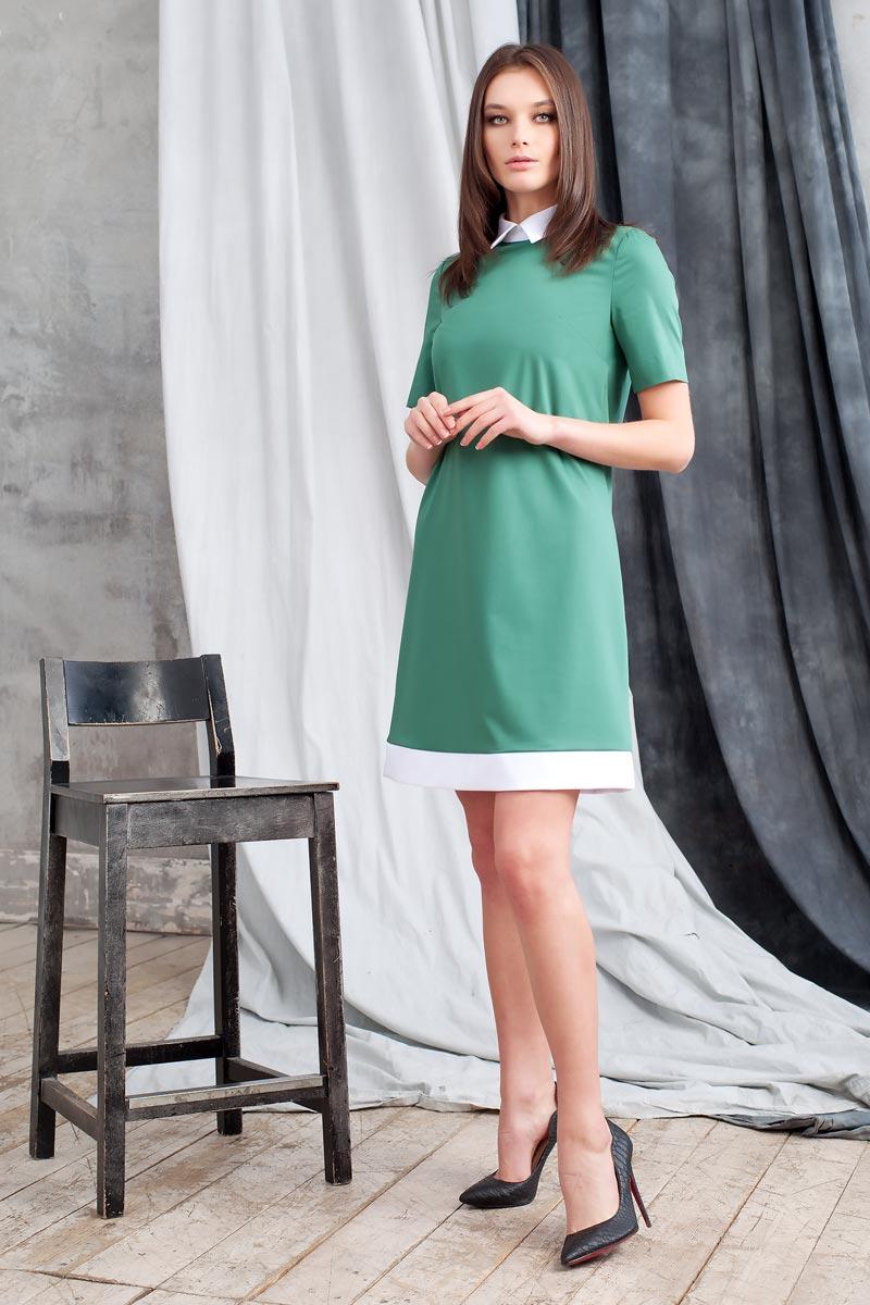 Платье Ruxara, цвет: зеленый. 0113741. Размер 460113741Элегантное платье из ткани костюмной группы. Модель трапециевидного силуэта с коротким рукавом. Низ платья оформлен полосой контрастного цвета. Воротник отложной на стойке с застежкой на пуговицы сзади. В среднем шве спинки застежка на потайную молнию. Нежное платье поможет создать образы на разные случаи жизни.