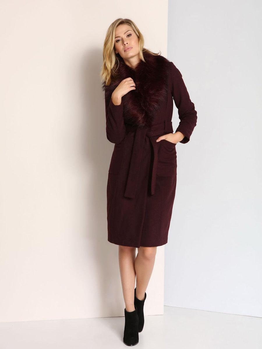 Пальто женское Top Secret, цвет: бордовый. SPZ0351CE. Размер 38 (44)SPZ0351CEСтильное женское пальто Top Secret выполнено из сочетания высококачественных материалов. Подкладка изготовлена из полиэстера. Модель с отложным воротником с лацканами и длинными рукавами застегивается на металлические кнопки. Воротник оформлен искусственным мехом, который пристегивается с помощью молнии. Спереди на модели расположены два накладных кармана. На поясе предусмотрены шлевки для ремня и небольшой ремешок.