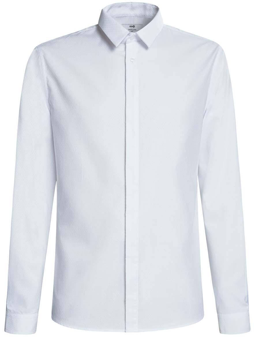 Рубашка3L110226M/44482N/1000OСтильная мужская рубашка oodji выполнена из хлопка с добавлением полиэстера. Модель с отложным воротником и длинными рукавами застегивается на пуговицы спереди. Манжеты рукавов дополнены застежками-пуговицами.