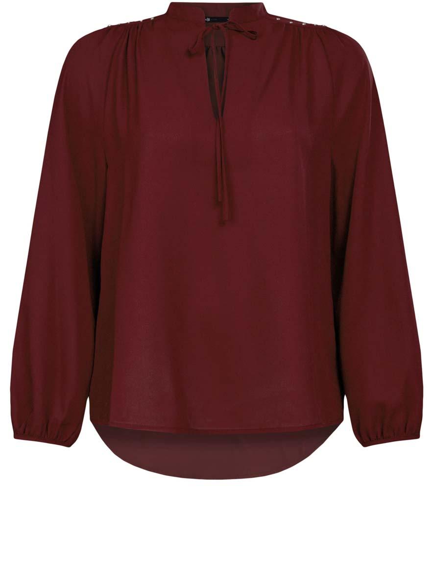 Блузка11411126/45873/4900NЖенская блузка oodji Ultra имеет свободный крой, воротник-стойку оформленный завязками и вырезом-капелькой, рукава-баллоны. Изделие декорировано металлическими кнопками по плечам. Блузка имеет скругленный низ, удлинена сзади.