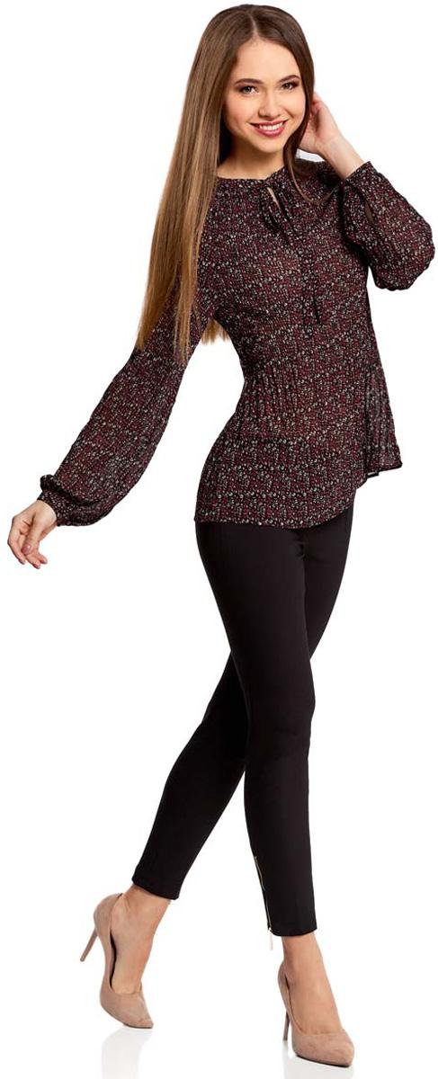 Блузка женская oodji Ultra, цвет: бордовый, розовый. 11414005/46166/494AF. Размер 34 (40-170)11414005/46166/494AFЖенская блузка oodji Ultra полностью выполнена из полиэстера. Модель из гофрированной ткани с воротником-аскот, узким вырезом на груди и длинными рукавами-реглан. Рукава дополнены манжетами с пуговицами.