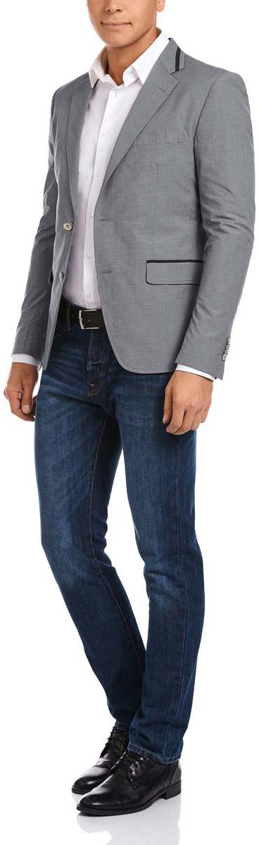 Пиджак2L440155M/44228N/2379OМужской пиджак oodji скроен по классическому силуэту и плотно садится по фигуре. Имеет длинные рукава, воротник с лацканами, карман слева на груди и два кармана по бокам от талии. Застегивается на пуговицы спереди и на манжетах. Сзади имеется шлица. Оформлен контрастной окантовкой.