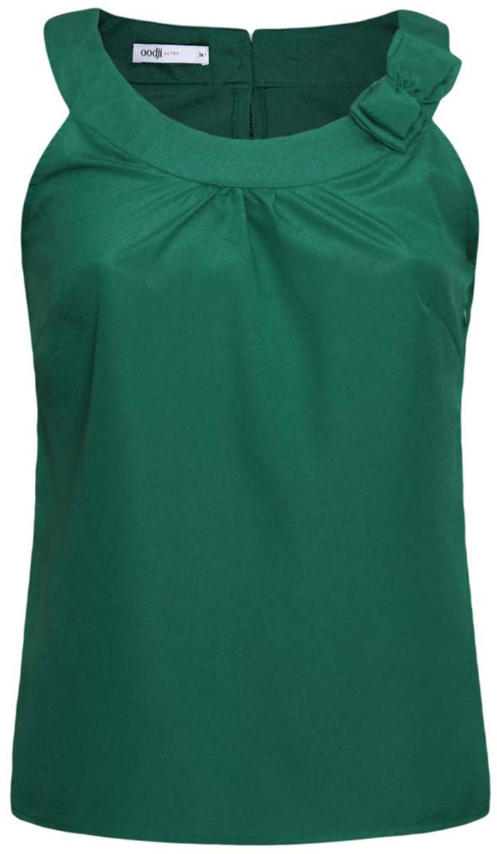 Блузка11403152-5/31427/6E00NЖенская блузка oodji Ultra выполнена полностью из полиэстера. Модель с круглым вырезом горловины, небольшим вырезом на спинке и без рукавов застегивается сбоку на скрытую молнию и на спинке на две пуговицы. Воротник дополнен декоративным бантом.