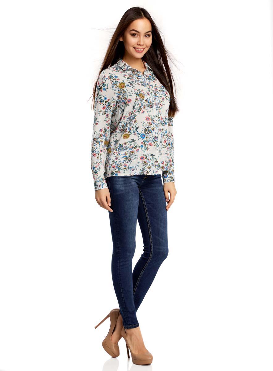 Рубашка11411098-1M/24681/1275EЖенская рубашка oodji Ultra выполнена из 100% вискозы. Модель с отложным воротником и длинными рукавами застегивается на пуговицы. Изделие оформлено цветочным принтом.