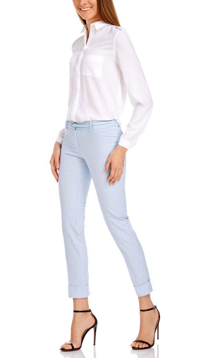 Брюки11703057-8/43273/1229CСтильные женские брюки oodji выполнены из хлопка, полиэстера с добавлением эластана. Модель со стандартной посадкой оформлена сзади декоративными вшитыми карманами. Спереди брюки имеют гульфик на молнии и застегиваются на пуговицу и застежку-крючок. Также модель оснащена шлевками и тонким ремнем с декоративной перфорацией. Низ брюк оформлен декоративными подворотами.