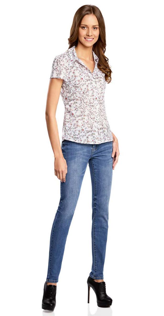 Блузка21407022-7M/12836/1262FЖенская блузка oodji Collection выполнена из натурального хлопка. Модель с отложным воротником и короткими рукавами застегивается на пуговицы. Оформлено изделие оригинальным принтом.