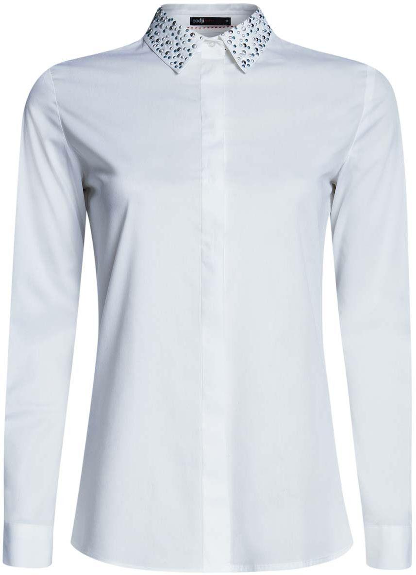 Рубашка11410019/26357/2900XСтильная женская рубашка oodji выполнена из хлопка с добавлением полиэстера. Модель с отложным воротником и длинными рукавами застегивается на пуговицы. Манжеты рукавов оснащены застежками-пуговицами. Модель оформлена металлическими стразами.