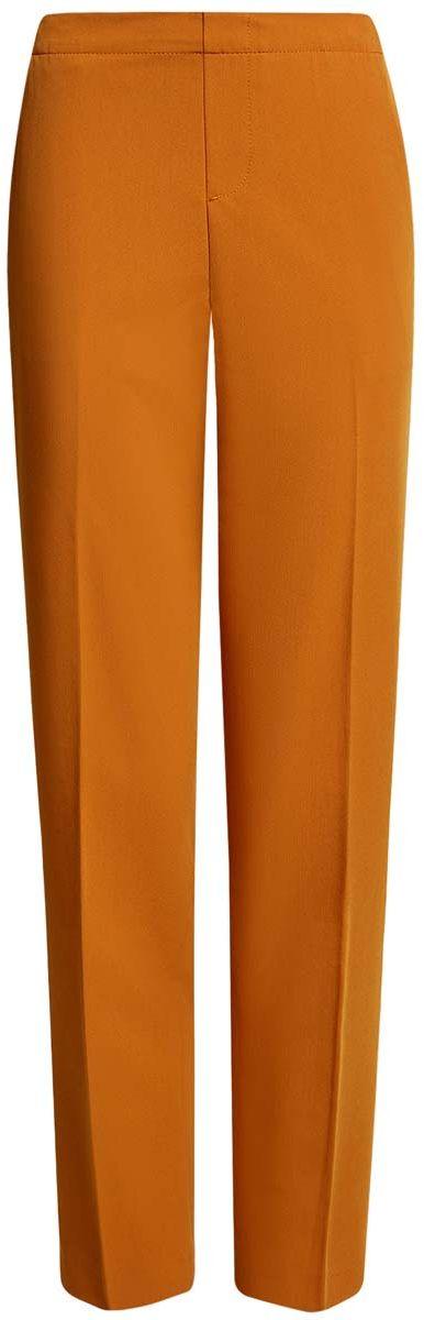 Брюки11706203/38253/5900NЖенские брюки oodji Ultra стандартной посадки изготовлены из полиэстера с добавлением вискозы и полиуретана. На поясе брюки дополнены широкой эластичной резинкой, спереди оформлены имитацией ширинки. По бокам расположены втачные карманы, сзади имитация двух прорезных кармашков.