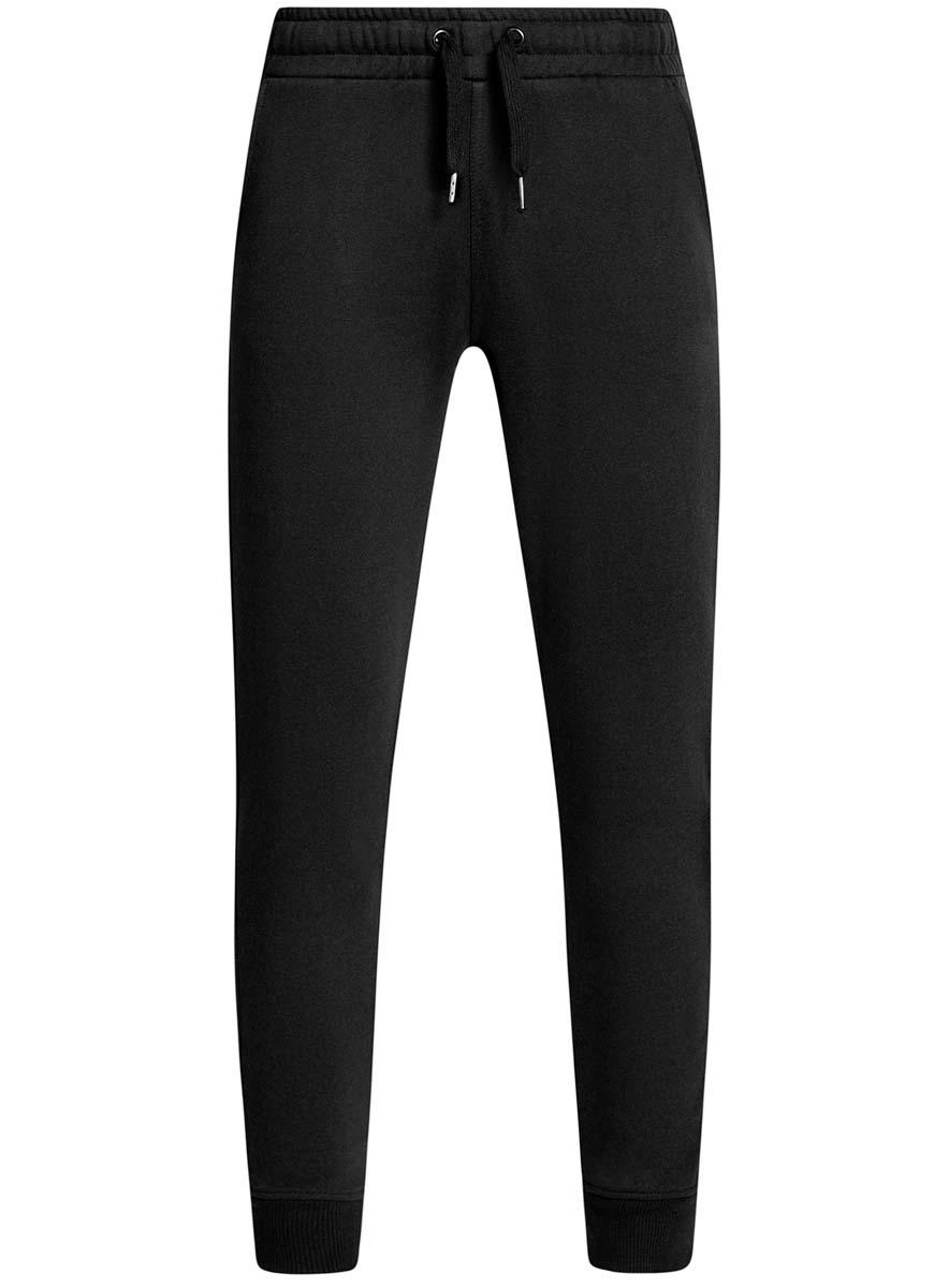 Брюки спортивные мужские oodji Basic, цвет: черный. 5B200004M/44119N/2900N. Размер XS (44)5B200004M/44119N/2900NУдобные мужские спортивные брюки oodji Basic, выполненные из хлопка, великолепно подойдут для отдыха, повседневной носки, а также для занятий спортом. Брюки зауженного к низу кроя и средней посадки имеют широкую эластичную резинку на поясе, объем талии регулируется при помощи шнурка-кулиски. Спереди изделие имеет два втачных кармана, а сзади один накладной. Низ брючин дополнен широкими манжетами.