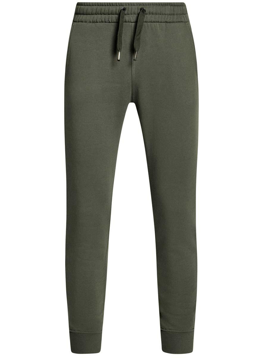Брюки спортивные5B200004M/44119N/2300MУдобные мужские спортивные брюки oodji Basic, выполненные из хлопка, великолепно подойдут для отдыха, повседневной носки, а также для занятий спортом. Брюки зауженного к низу кроя и средней посадки имеют широкую эластичную резинку на поясе, объем талии регулируется при помощи шнурка-кулиски. Спереди изделие имеет два втачных кармана, а сзади один накладной. Низ брючин дополнен широкими манжетами.