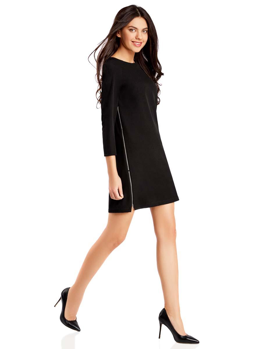Платье oodji Ultra, цвет: черный. 11914002/42354/2900N. Размер 34-170 (40-170)11914002/42354/2900NОригинальное платье прямого кроя oodji Ultraвыполнено из качественного трикотажа. Модель мини-длины с рукавами 3/4 и круглым вырезом горловинызастегивается на короткую молнию на спинке. По бокам платье дополнено декоративными молниями во всю длину.