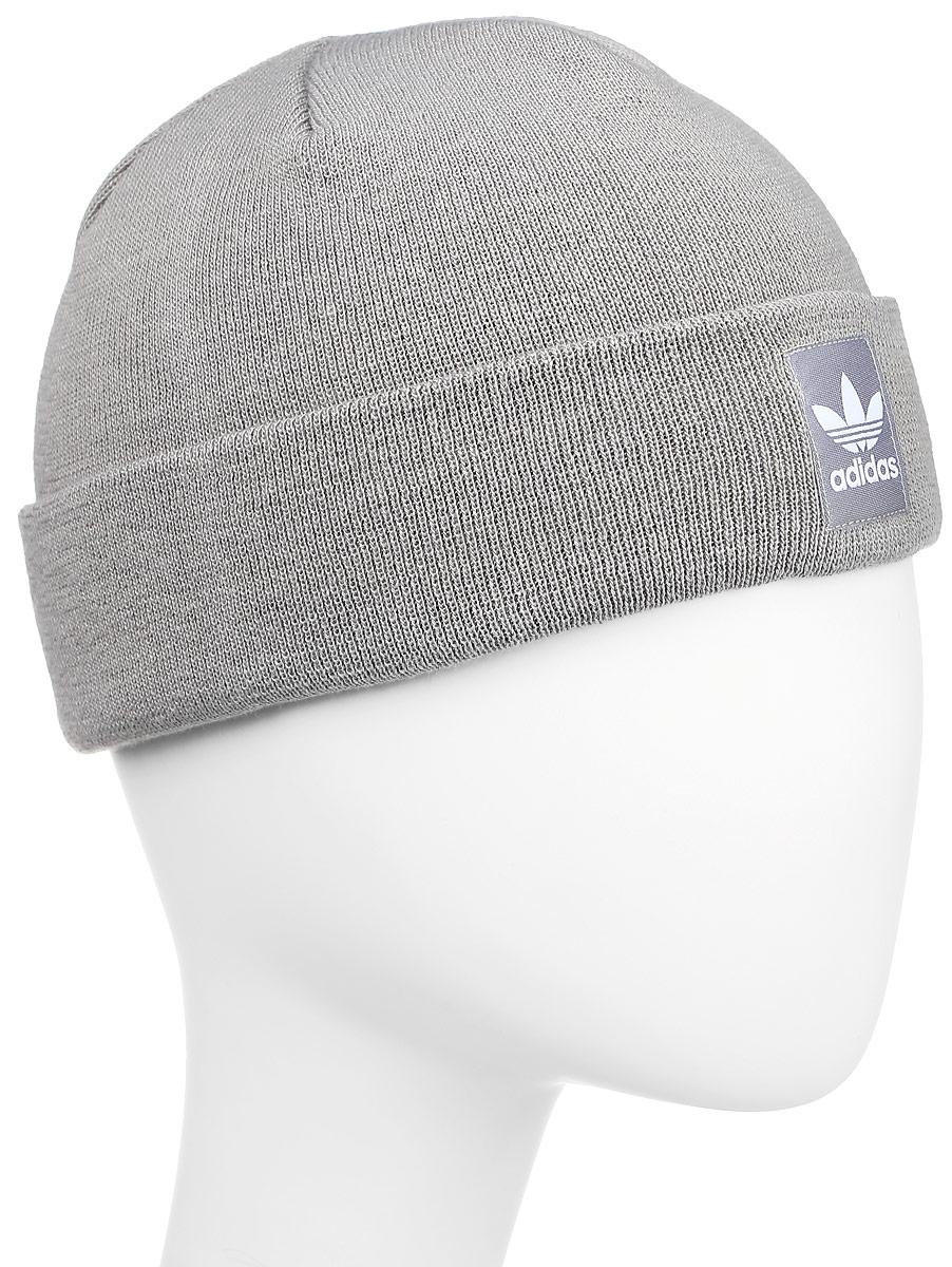 ШапкаAY9071Шапка Adidas Rib Logo Beanie - классическая шапка-бини, связанная из мягкой меланжевой пряжи. Три полоски украшают внутреннюю сторону подвернутого манжета. Атласная нашивка с Трилистником на отвороте.