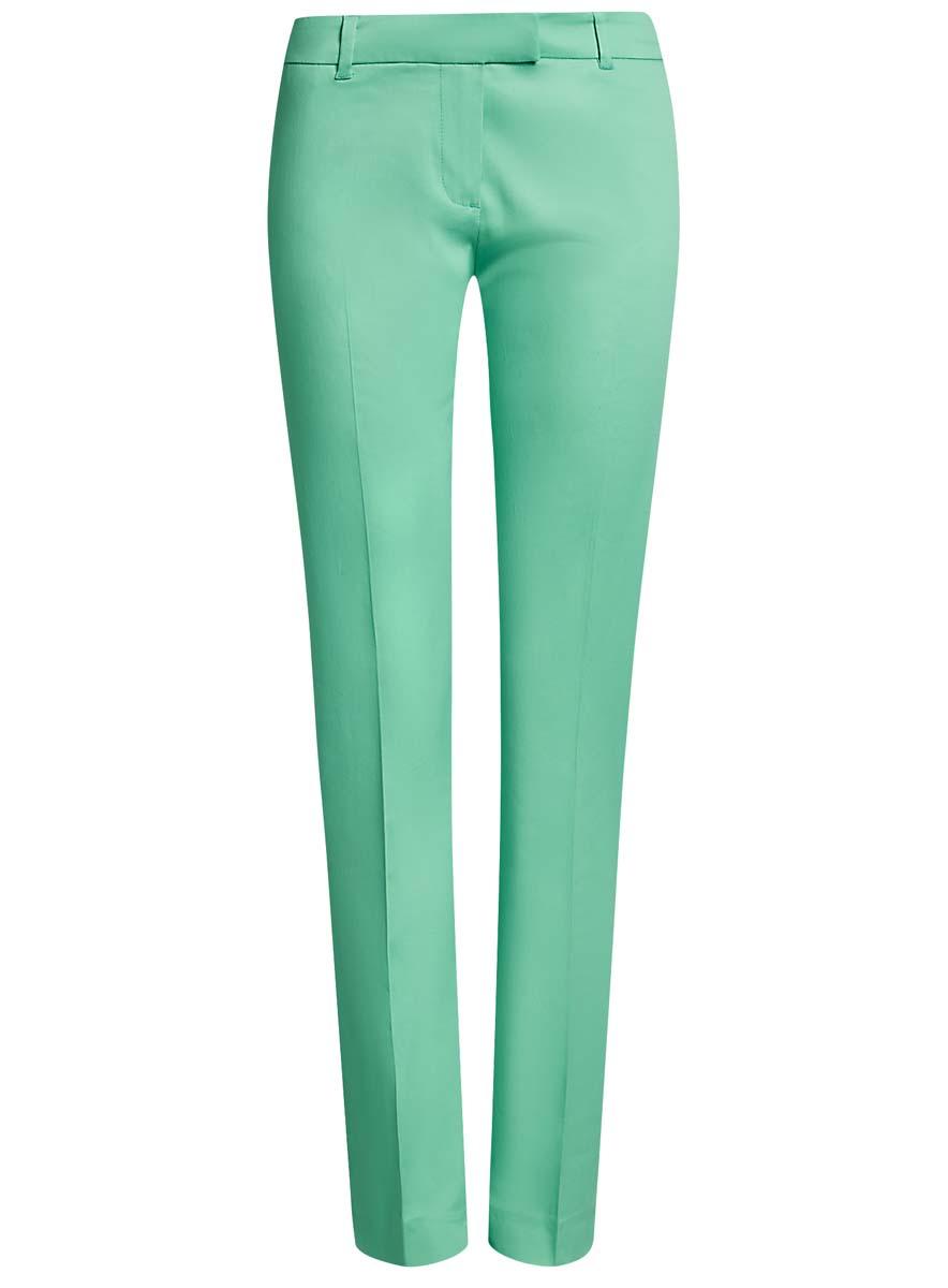 Брюки21704159-1B/14522/4300NСтильные женские брюки oodji выполнены из хлопка и эластана, комфортны при движении. Модель со стандартной посадкой оформлена сзади декоративными вшитыми карманами. Спереди брюки имеют гульфик на молнии и застегиваются на пуговицу и застежку-крючок. Также брюки оснащены открытыми карманами и шлевками.