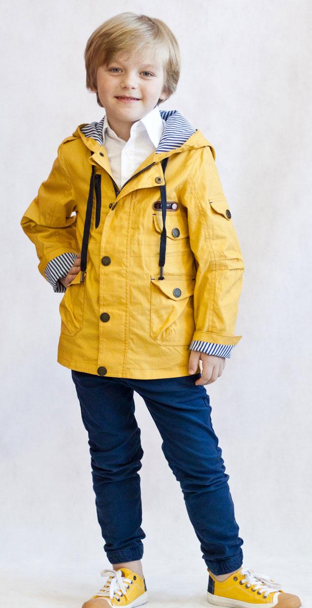 Ветровка для мальчика OLDOS Назар, цвет: горчичный. 3К1707-1. Размер 98, 3 года3К1707Легкая стильная ветровка Назар от Oldos идеальна для прохладной погоды с температурой +10…+20°С. Внешняя ткань из хлопка с водоотталкивающей пропиткой защищает от ветра и дождя. Принтованная подкладка из бязи приятна на ощупь. Модель застегивается на молнию. Ветрозащитная планка по всей длине молнии закрывается на кнопки. Ветровка оснащена несъемным капюшоном, объем которого можно отрегулировать. Рукава модели прямые, с декоративным отворотом. Талия куртки снабжена внутренней регулируемой утяжкой для идеальной посадки. Также ветровка оснащена вместительными накладными карманами с клапанами на кнопках и светоотражающими элементами для безопасных прогулок в темное время суток.