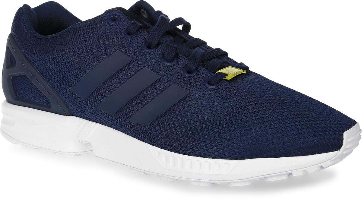 Кроссовки мужские adidas Originals Zx Flux, цвет: темно-синий. M19841. Размер 10,5 (44)M19841Кроссовки adidas Zx Flux выполнены из текстиля и оформлены фирменными накладками из термополиуретана. Шнурки надежно зафиксируют модель на ноге. Внутренняя поверхность из сетчатого текстиля комфортна при движении. Стелька выполнена из легкого ЭВА-материала с поверхностью из текстиля. Подошва изготовлена из высококачественной резины и дополнена протектором. В комплект входят дополнительные шнурки.