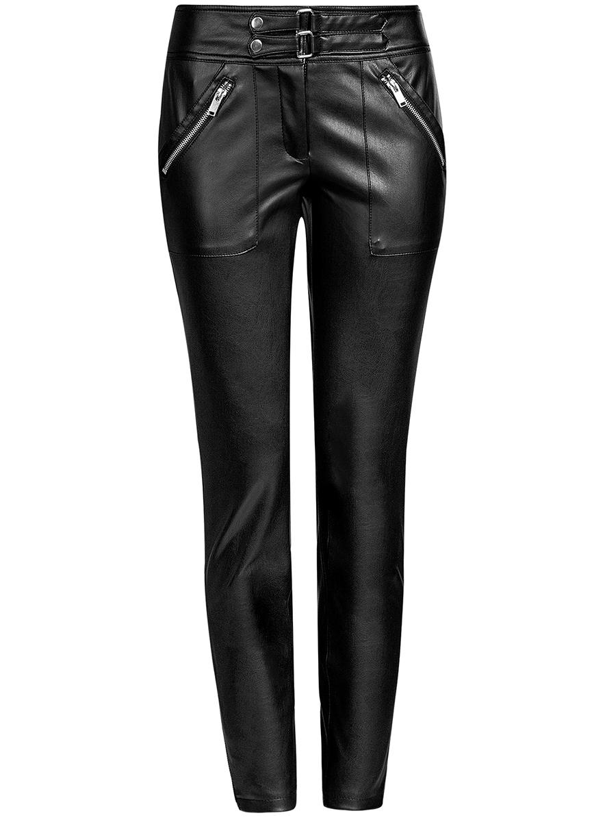 Брюки18G07089/45902/2900NЖенские брюки oodji Ultra выполнены из искусственной кожи. Модель-слим стандартной посадки застегивается на кнопки в поясе и ширинку на застежке-молнии. Спереди брюки дополнены накладными карманами на молниях. Брючины внизу по бокам дополнены молниями.