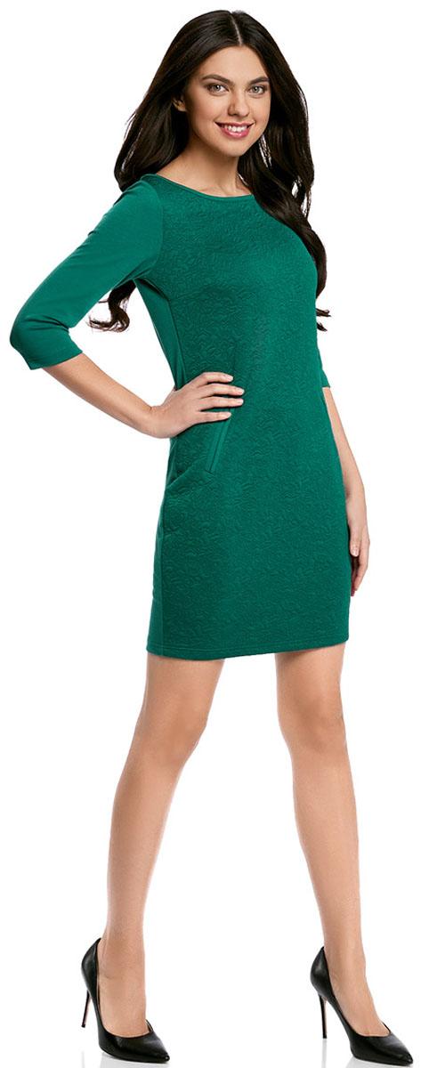 Платье oodji Collection, цвет: темно-изумрудный. 24001100-4/46435/6E00N. Размер M (46-170)24001100-4/46435/6E00NПлатье oodji Collection, выгодно подчеркивающее достоинства фигуры, выполнено из плотного фактурного трикотажа. Модель средней длины с вырезом лодочкой и рукавами 3/4 дополнена двумя прорезными карманами на юбке.
