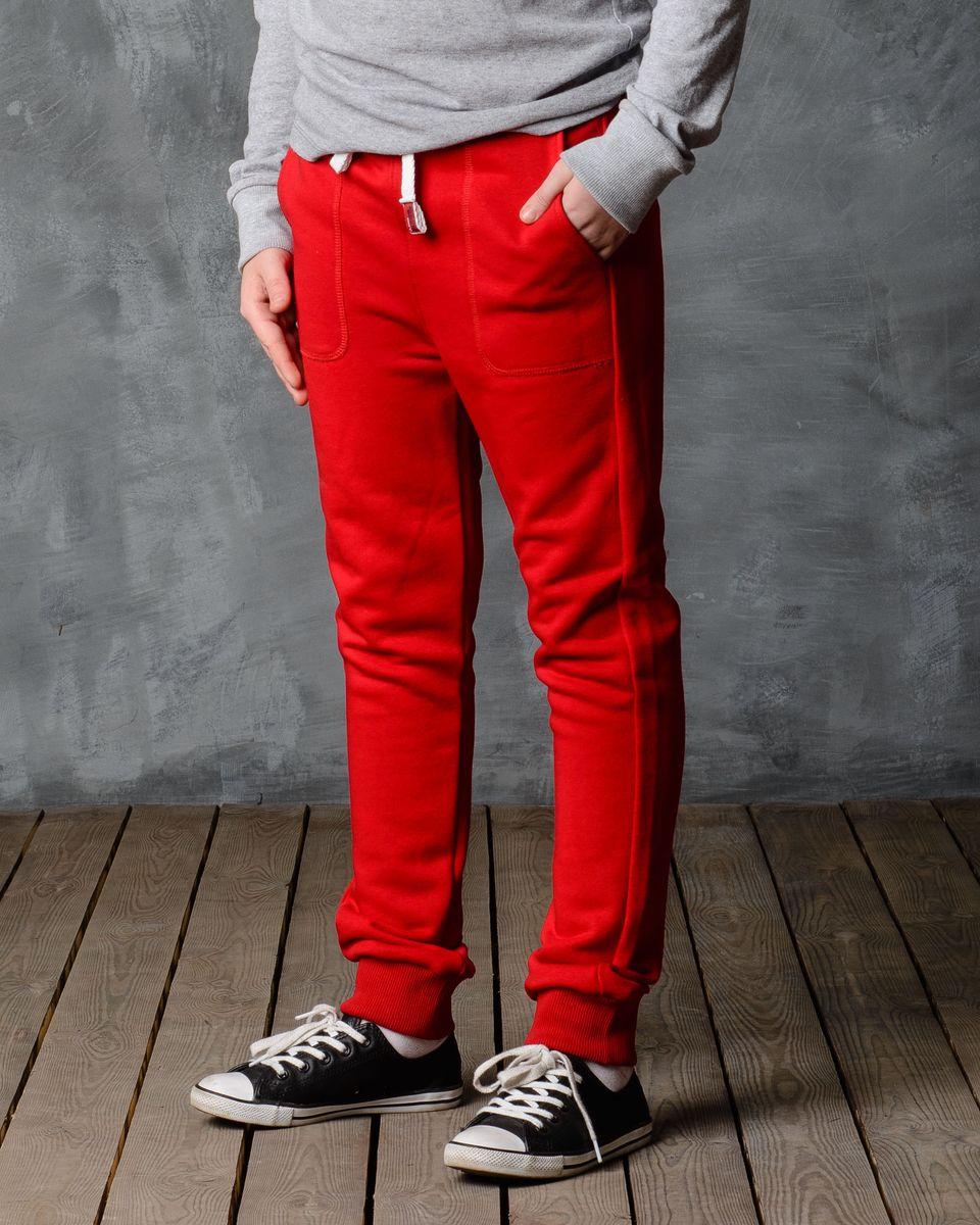 Брюки спортивные для мальчика Modniy Juk, цвет: красный. 15В00080700. Размер 110/11615В00080700/BASE/Спортивные брюки Modniy Juk изготовлены из высококачественной мягкой ткани. Модель полуприлегающего силуэта заужена к низу. Комфортный мягкий пояс и манжеты из трикотажной резинки. Брюки дополнены боковыми карманами.