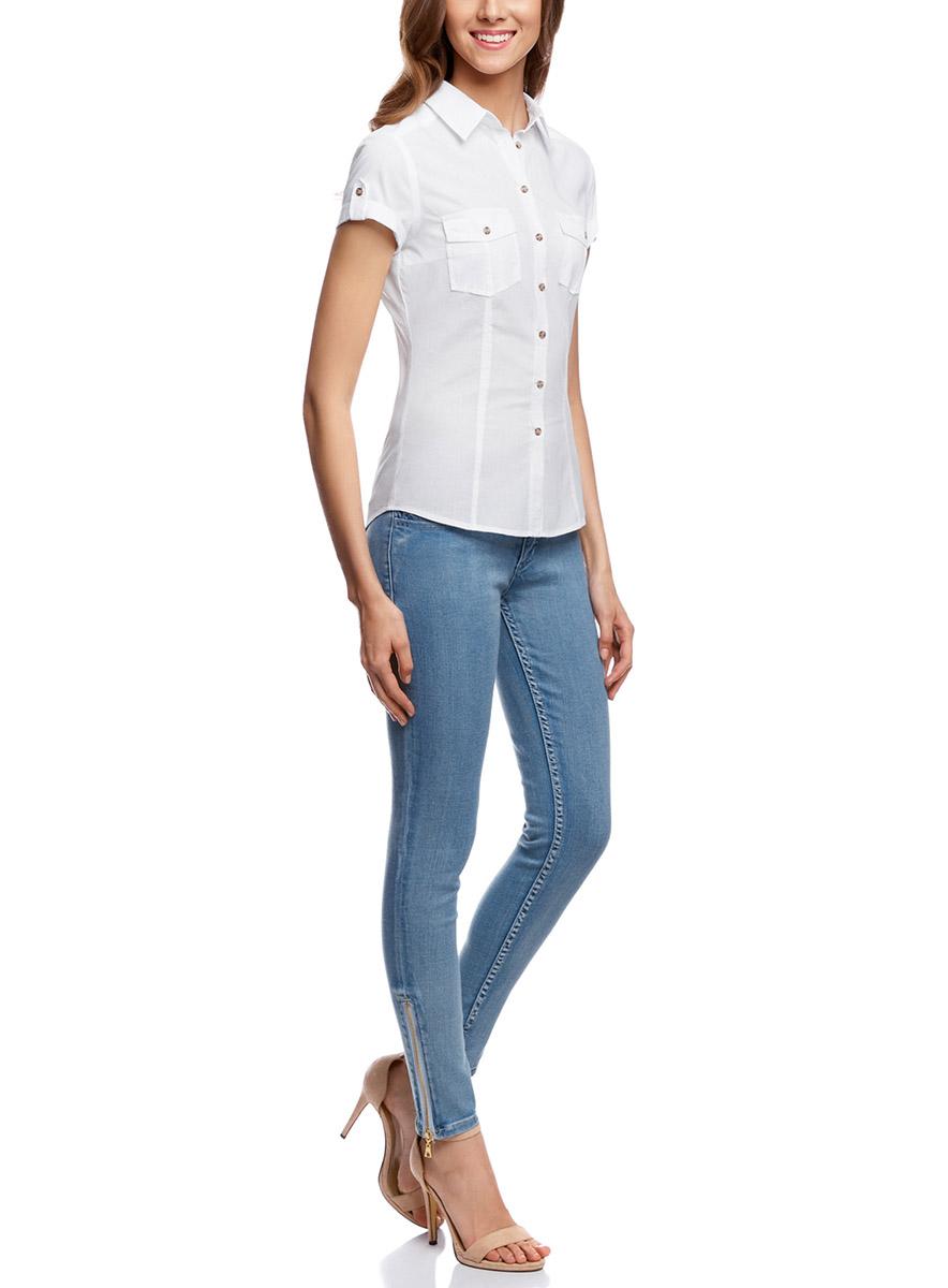 Рубашка11402084-5B/45510/5200NЖенская рубашка oodji Ultra выполнена из натурального хлопка. Модель с отложным воротником и короткими рукавами на груди дополнена двумя накладными карманами с клапанами на пуговицах.