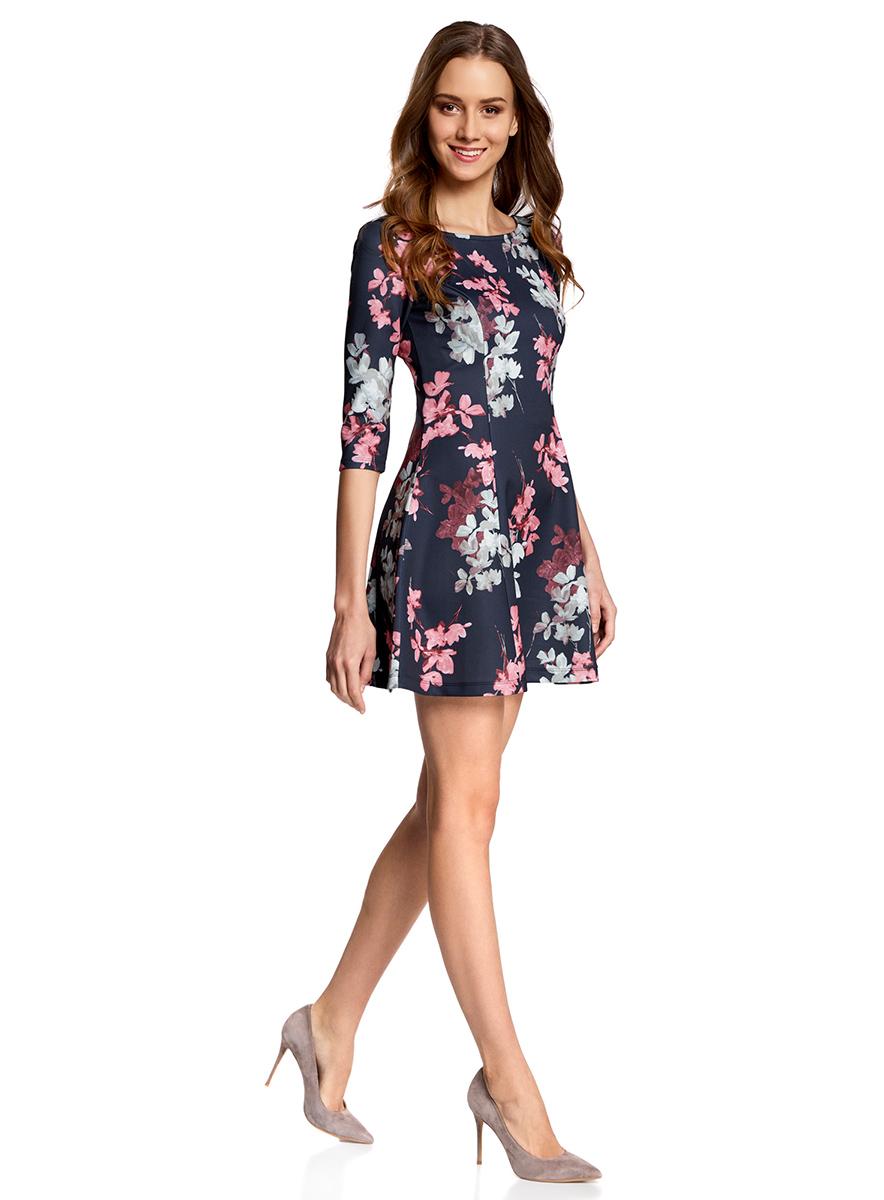 Платье oodji Ultra, цвет: темно-синий, розовый. 14001150-3/33038/7941F. Размер XXS (40)14001150-3/33038/7941FСтильное платье oodji Ultra, выполненное из качественного полиэстера с небольшим добавлением эластана, отлично дополнит ваш гардероб. Модель-мини с круглым вырезом горловины и стандартными рукавами 3/4 оформлена оригинальным цветочным принтом.