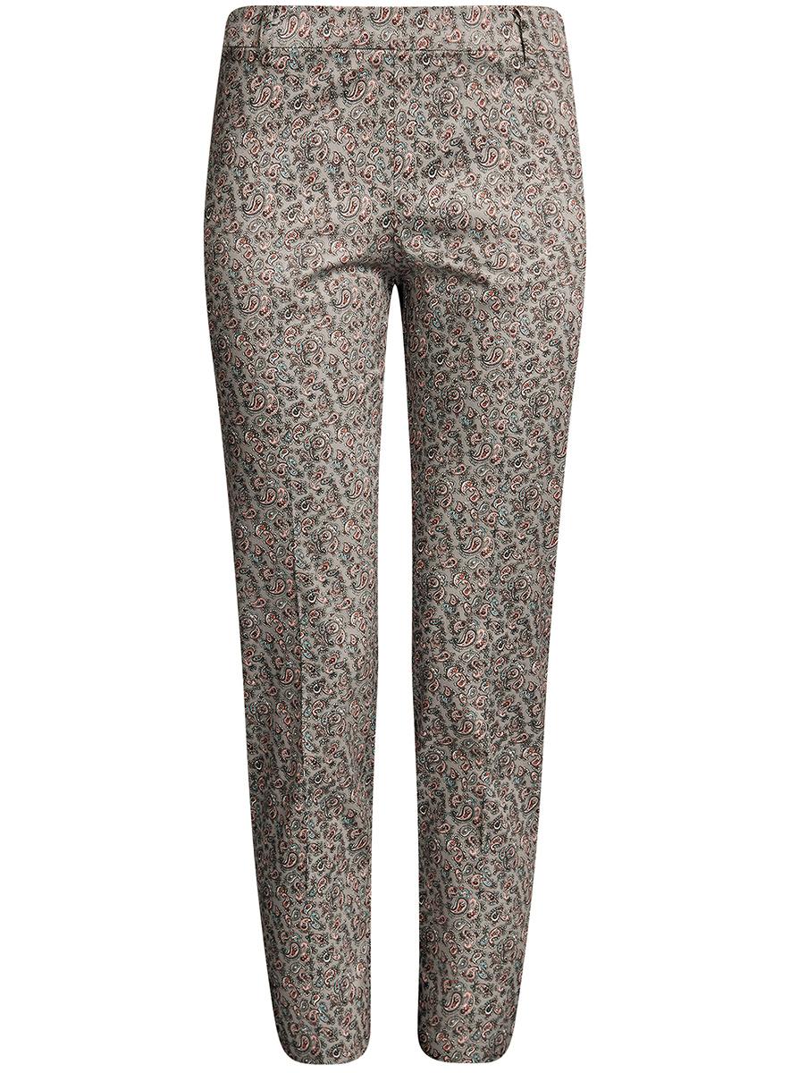 Брюки21706022B/14522/5700NСтильные женские брюки oodji Collection изготовлены из натурального хлопка с добавлением эластана. Модель-слим со стандартной посадкой выполнена в лаконичном стиле и по низу брючин оформлена небольшими разрезами. Застегиваются брюки по боковому шву на застежку- молнию. Сзади изделие оформлено прорезным карманом-обманкой, а в поясе имеет шлевки для ремня.