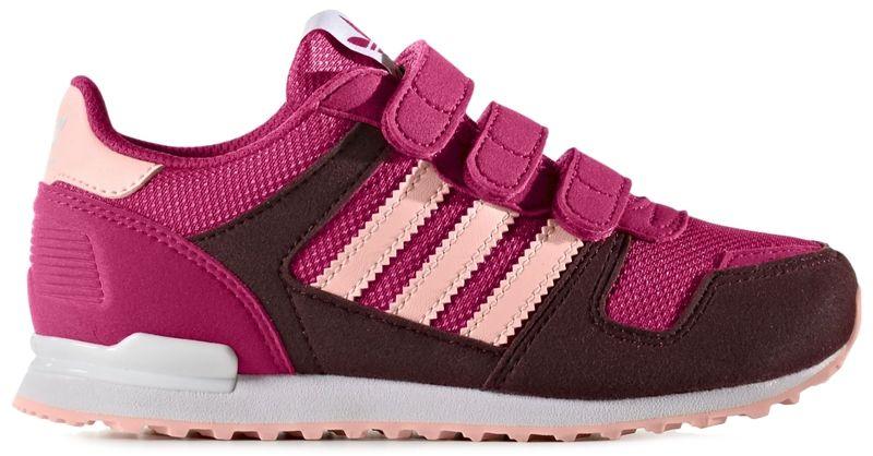 КроссовкиBB2447Эти кроссовки для юных модников напоминают о 1985 годе, когда появилась легендарная модель ZX 700. Элегантный стиль ретро обновлен новой комбинацией цветов. Верх из сетки и замши дополнен удобными застежками на липучках.