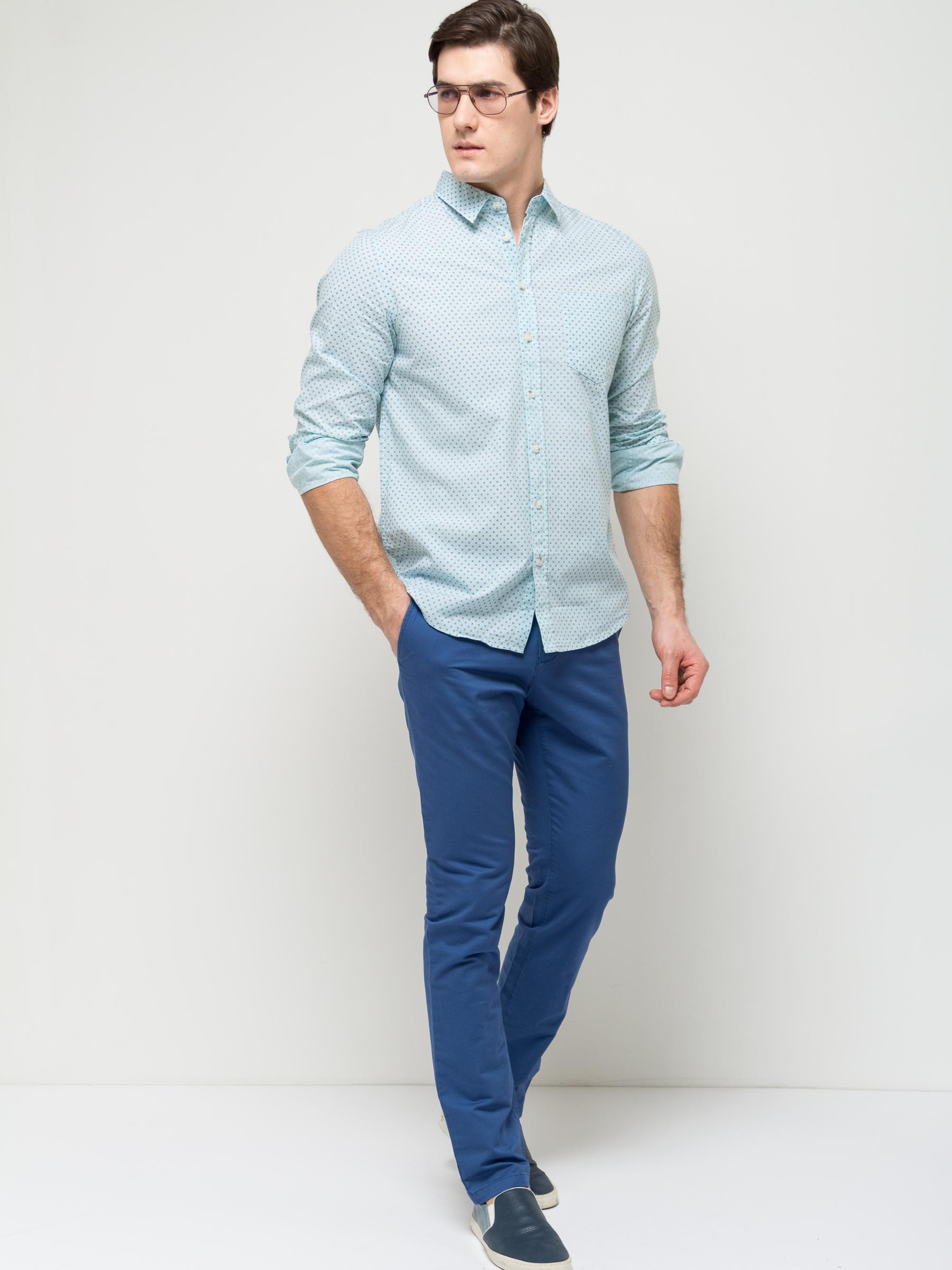 Рубашка мужская Sela, цвет: дымчатый ментол. H-212/749-7112. Размер 41 (48)H-212/749-7112Стильная мужская рубашка Sela выполнена из натурального хлопка и оформлена принтом в мелкий горошек. Модель полуприлегающего кроя с длинными рукавами и отложным воротничком застегивается на пуговицы и дополнена накладным карманом на груди. Манжеты рукавов также дополнены пуговицами.Яркий цвет модели позволяет создавать стильные образы.