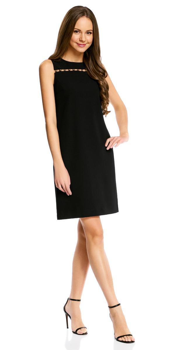 Платье21901165/46414/2900NСтильное платье прямого кроя oodji Collection выполнено из комбинированного материала. Модель мини-длины с открытыми плечами и круглым вырезом горловины застегивается на скрытую застежку-молнию на спинке. На груди платье декорировано полукруглыми металлическими элементами.