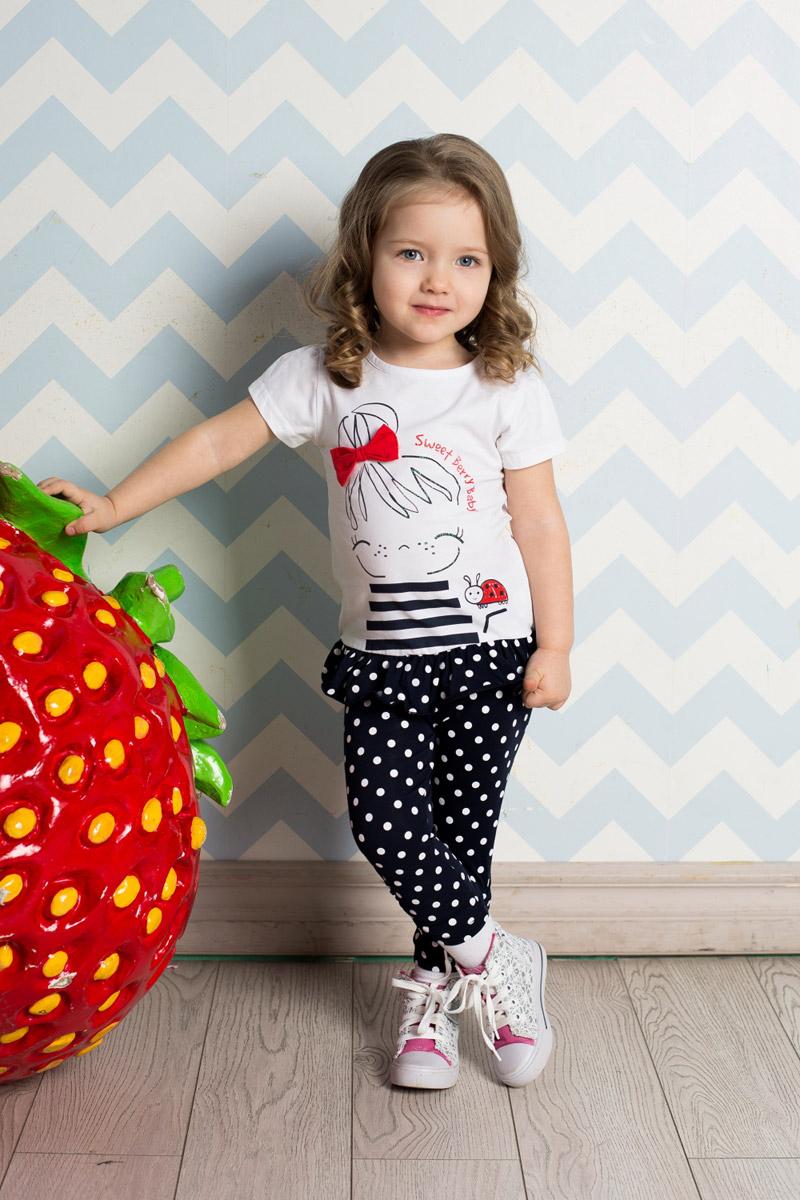 Футболка712058Яркая футболка для девочки Sweet Berry выполнена из качественного эластичного хлопка. Удлиненная модель с круглым вырезом горловины и короткими рукавами-фонариками оформлена контрастной вставкой-воланом по низу и оригинальным принтом с объемным бантиком. Воротник дополнен мягкой эластичной бейкой.