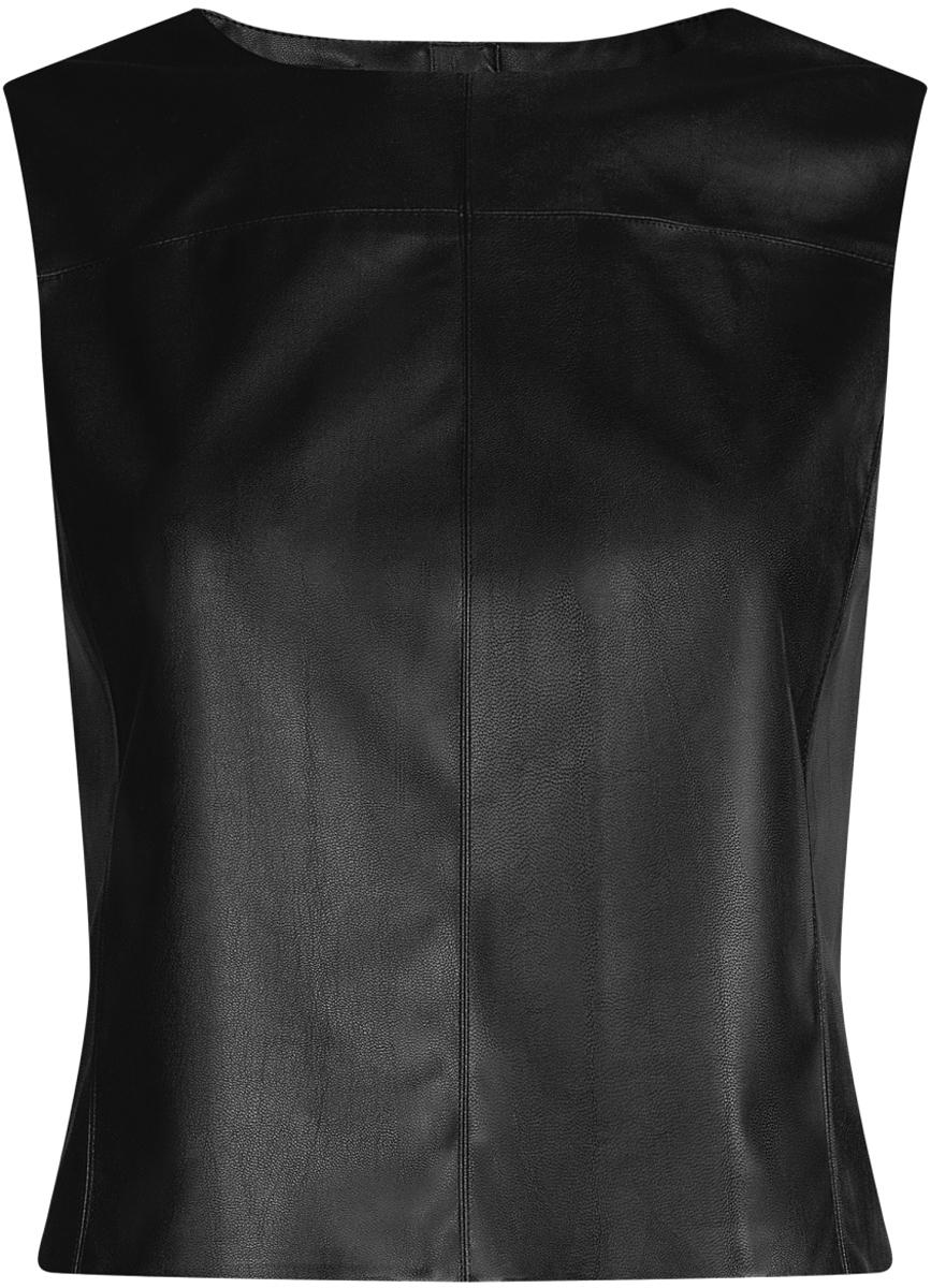 Жилет женский oodji Ultra, цвет: черный. 18C00001/45085/2900N. Размер 36-170 (42-170)18C00001/45085/2900NЛаконичный женский жилет oodji Ultra выполнен из качественной искусственной кожи. Модель приталенного кроя с круглым вырезом горловины застегивается на металлическую молнию на спинке. Жилет можно сочетать с рубашками и блузами или использовать как самостоятельную часть одежды. Такой жилет подойдет для офиса, прогулок и дружеских встреч и будет отлично сочетаться с джинсами и брюками, а также гармонично смотреться с юбками.