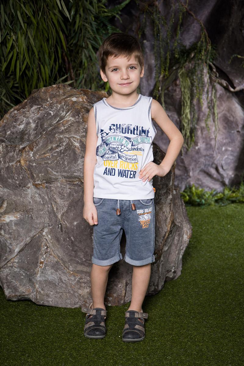 Шорты713144Стильные шорты для мальчика Sweet Berry выполнены из мягкого трикотажного материала и оформлены модным принтом. Модель с отворотами имеет пояс на мягкой резинке, дополнительно регулируемый шнурком. Спереди изделие дополнено двумя втачными карманами.