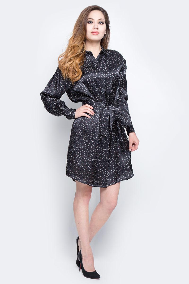 Платье Diesel, цвет: черный. 00SVBK-0NANW/900. Размер L (46)00SVBK-0NANW/900Оригинальное платье Diesel изготовлено из 100% шелка. Модель имеет длинные рукава с манжетами на пуговицах и отложной воротник. Платье по всей длине застегивается на пуговицы, скрытые планкой. В комплекте поставляется пояс. Модель дополнена необычным принтом в виде спичек. Такая оригинальная модель прекрасно подойдет в качестве платья, а также длинной блузки, которую можно носить в распашку поверх топов.
