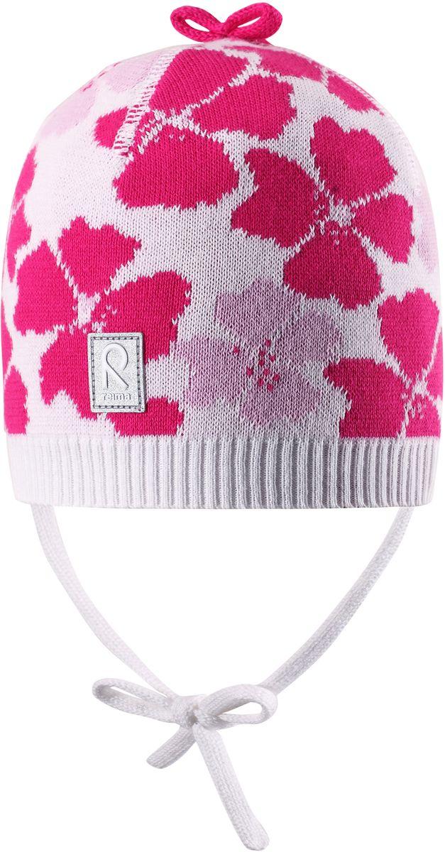 Шапка для девочки Reima Brisky, цвет: белый. 5184040100. Размер 485184040100Детская шапка яркой расцветки рассчитана на межсезонье, в ней можно и поиграть во дворе, и прогуляться по городу. Она изготовлена из мягкого и комфортного вязаного хлопка. Эта облегченная модель без подкладки, идеально подходит для солнечной погоды.