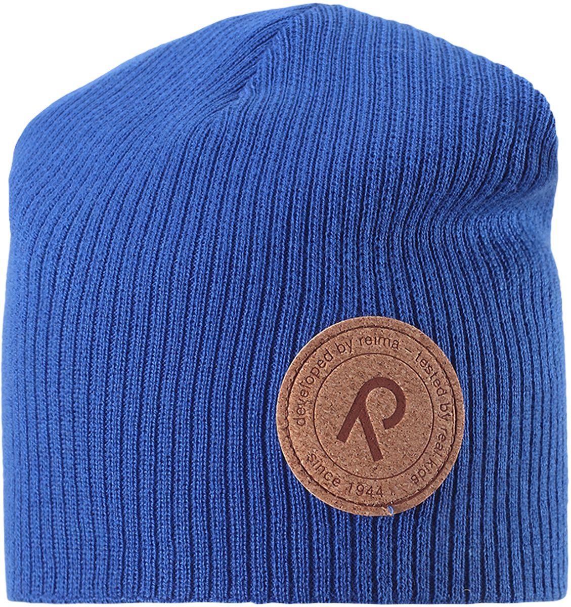Шапка детская Reima Majakka, цвет: синий. 5285266530. Размер 545285266530Детская шапка прекрасно подойдет для весенней поры. Она изготовлена из эластичного и легкого вязаного хлопка, мягкого и приятного на ощупь. Материал сертифицирован по стандарту Oeko-Tex. Удлиненная модель с подкладкой. Шапка смотрится ярко и стильно то, что надо для прогулки!