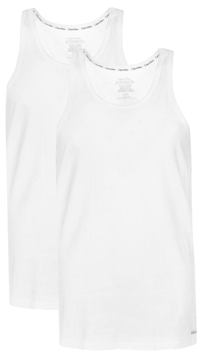 Майка мужская Calvin Klein Underwear, цвет: белый, 2 шт. NU8703A. Размер M (46/48)NU8703AМужская майка Calvin Klein Underwear изготовлена из натурального хлопка с добавлением эластана. Модель выполнена глубокой круглой горловиной и без рукавов. Майка дополнена квадратной нашивкой с названием бренда.