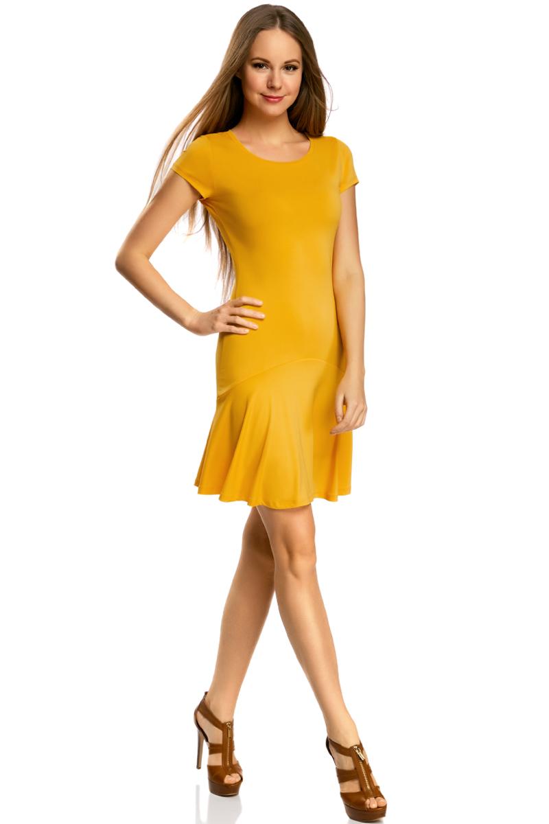 Платье oodji Ultra, цвет: желтый. 14011017/46384/5200N. Размер L (48)14011017/46384/5200NПриталенное платье oodji Ultra с юбкой-воланами выполнено из качественного трикотажа. Модель средней длины с круглым вырезом горловины и короткими рукавами выгодно подчеркнет достоинства фигуры.