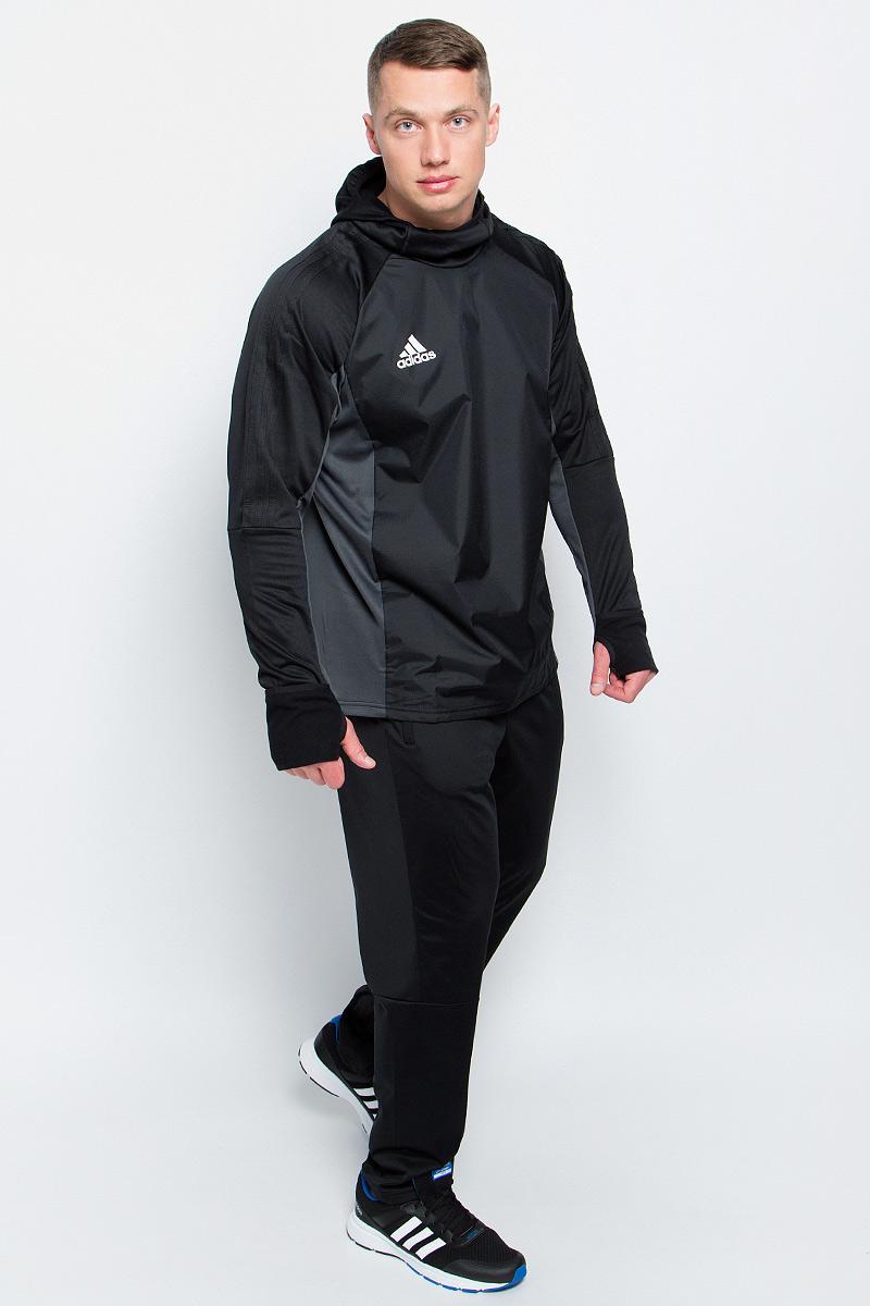 ТолстовкаAY2867Мужская футбольная толстовка Adidas Tiro17 Warm Top изготовлена специально для тренировок в прохладную погоду. Модель сохраняет максимум тепла благодаря ткани с технологией climawarm и удлиненным манжетам с прорезями для больших пальцев. Приталенный крой и облегающий капюшон с эластичной окантовкой для дополнительной защиты от холода.