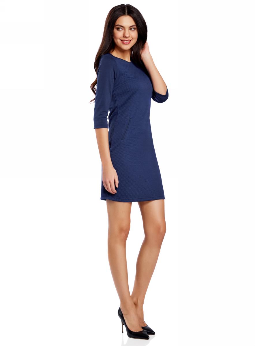 Платье oodji Collection, цвет: синий. 24001100-2/42408/7500N. Размер XL (50)24001100-2/42408/7500NПлатье от oodji облегающего силуэта выполнено из высококачественного трикотажа. Модель с рукавами 3/4 дополнена карманами.